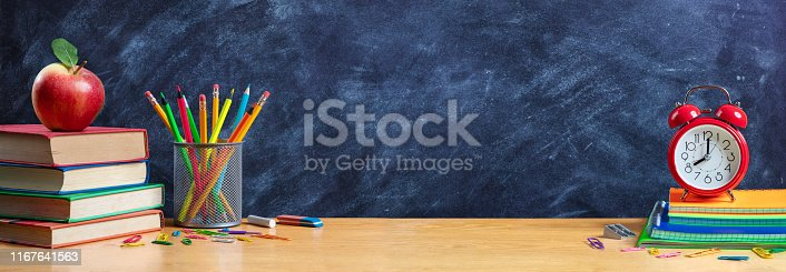 istock Apple On Stack Books With Pencils And Alarm Clock - Back To School 1167641563