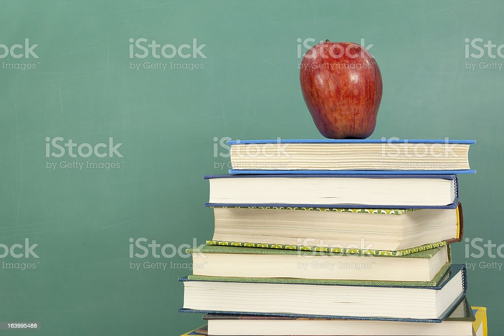 Apple on Stack of Books stock photo