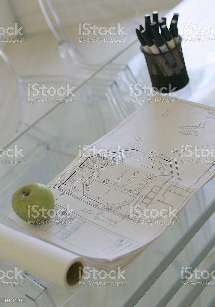 Apple on the blue print royalty-free stock photo