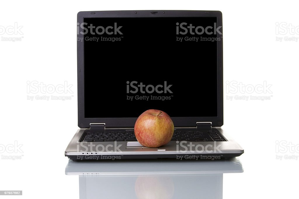 Apple on the laptop royalty-free stock photo