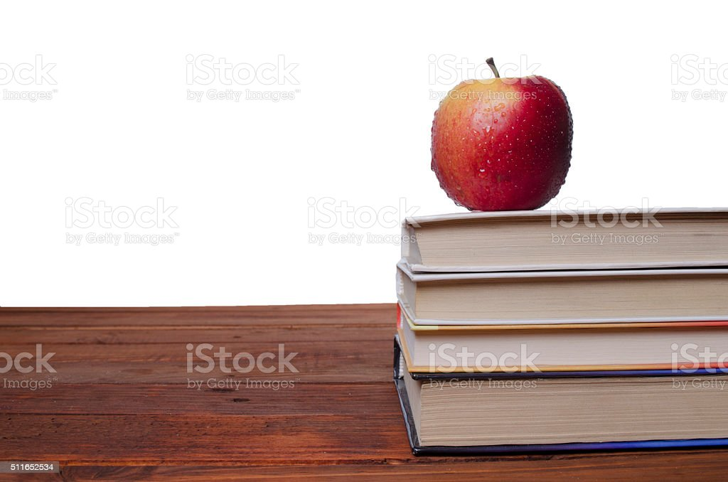 apple on the textbook stock photo