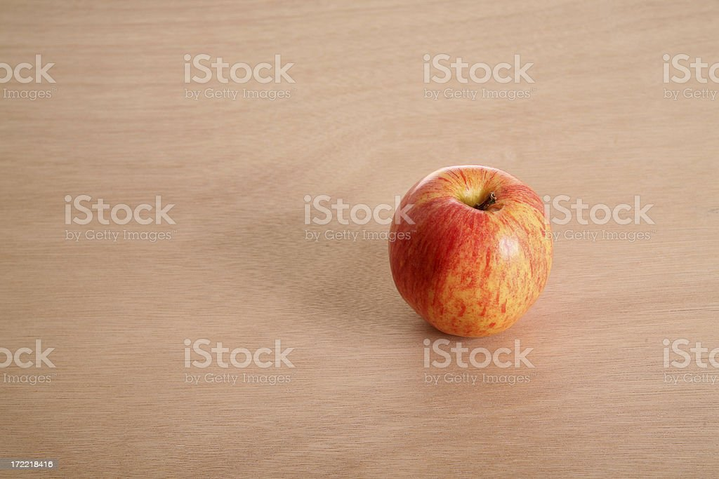 Apple on wood counter top royalty-free stock photo