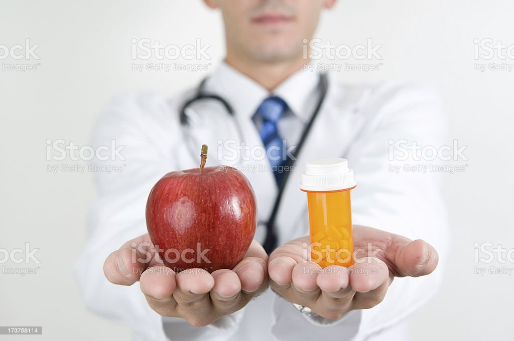 Apple or pills. Health in your hands. royalty-free stock photo