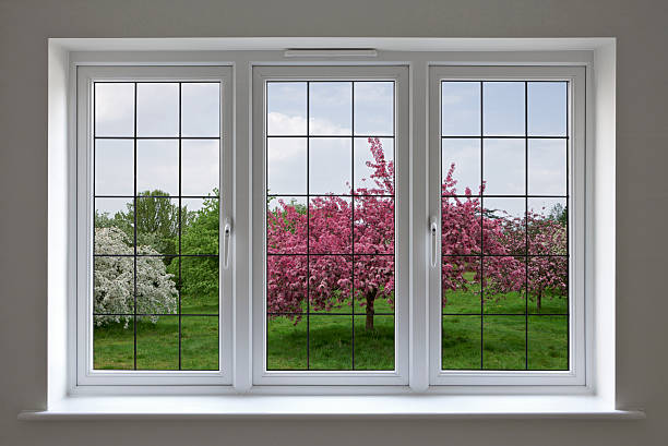 apple orchard through leaded glass window stock photo