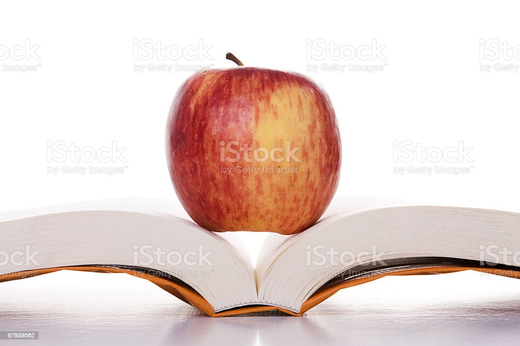 apple over a open book royalty-free stock photo