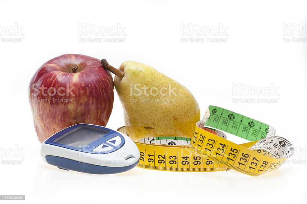 Apple, pear, tape and glucometer royalty-free stock photo