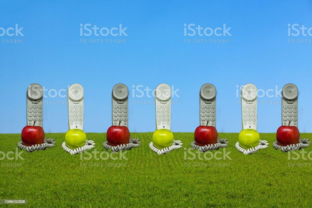 Apple phones on the horizon stock photo