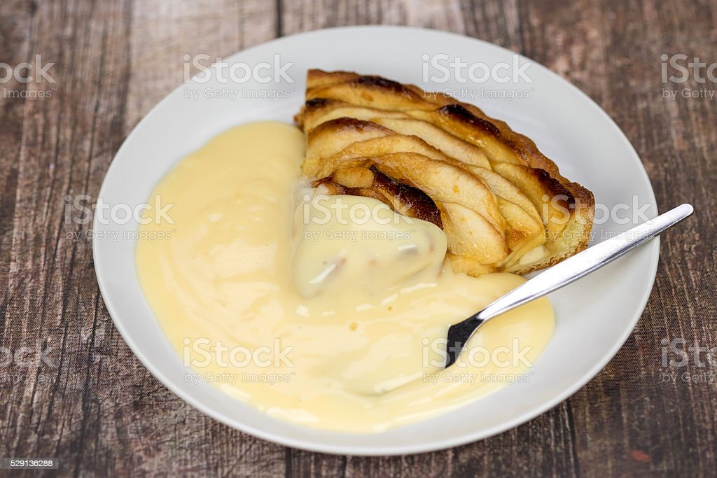 Apple pie and custard stock photo
