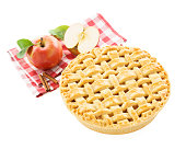 Homemade apple pie, apples and red checkered tablecloth isolated on white background.