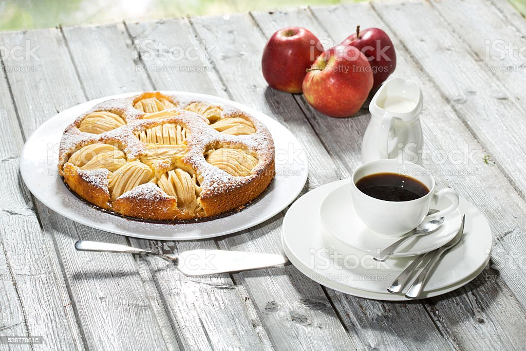 Apple pie, coffee cup and plate, apples on wood stock photo
