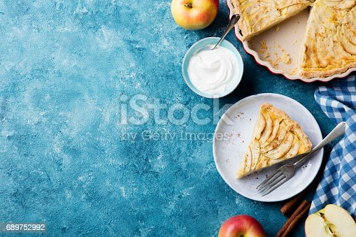 istock Apple pie on a blue background. Top view. Copy space. 689752992