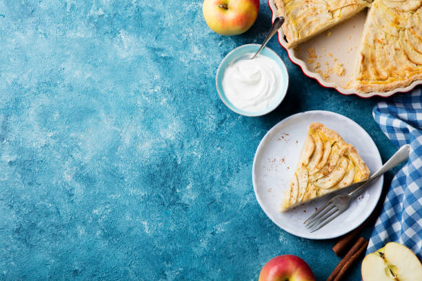 Apple pie on a blue background. Top view. Copy space. stock photo