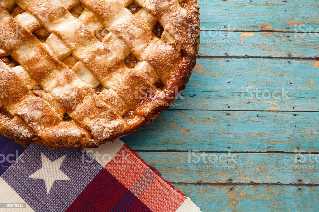 Apple pie on a blue wooden table stock photo