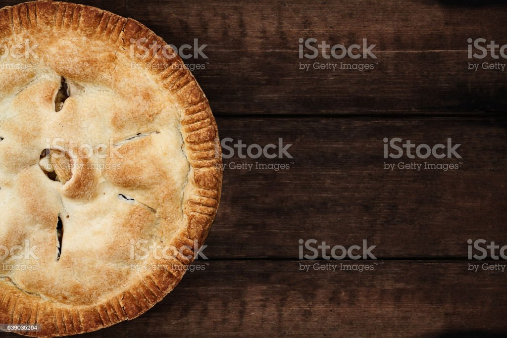 Apple Pie Over a Dark Wooden Table Top stock photo