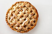 A lattice top apple pie on a light background.