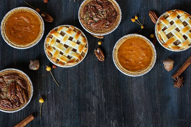 apple pie pumpkin pie and pecan pie - pumpkin pie 個照片及圖片檔