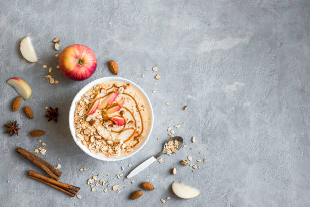 Apple Pie Smoothie Bowl Apple Pie Smoothie Bowl. Breakfast smoothie bowl with apples, cinnamon, almond milk, oat granola and spices, top view. oatmeal stock pictures, royalty-free photos & images