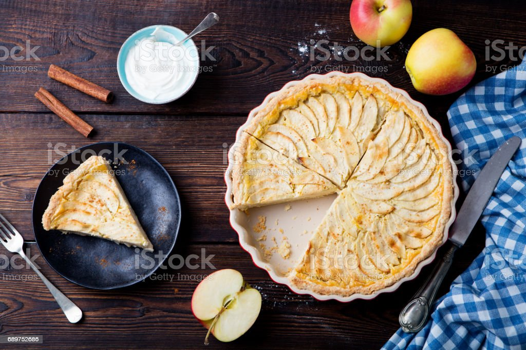 Apple pie, tart on a wooden background. Top view. stock photo
