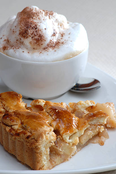 Apple pie with a cup of cappucino stock photo