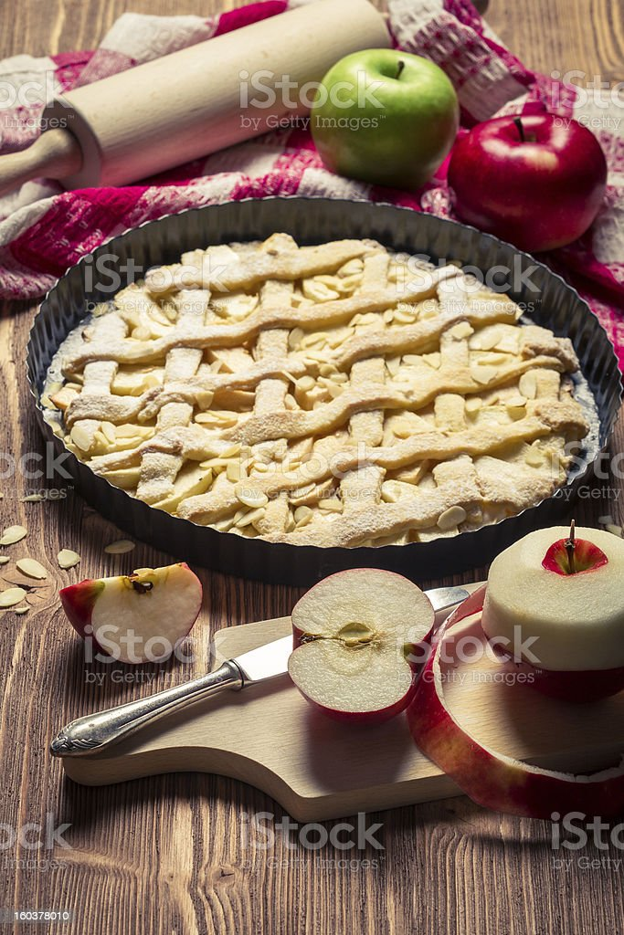 Apple pie with fresh fruits on old brown table royalty-free stock photo