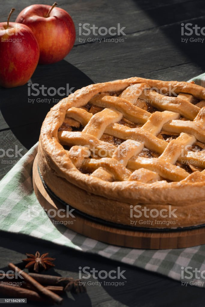 Vertical image of a delicious homemade apple pie, with a lattice...