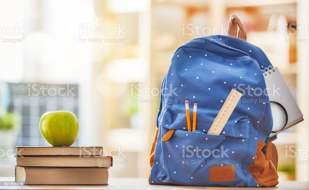 Apple, pile of books and pencils stock photo