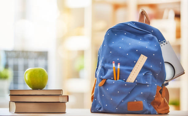 apple, pile of books and pencils - school building stock photos and pictures