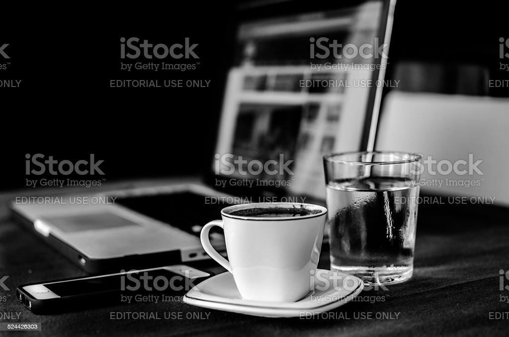 Apple Products in Home Office with Coffee stock photo