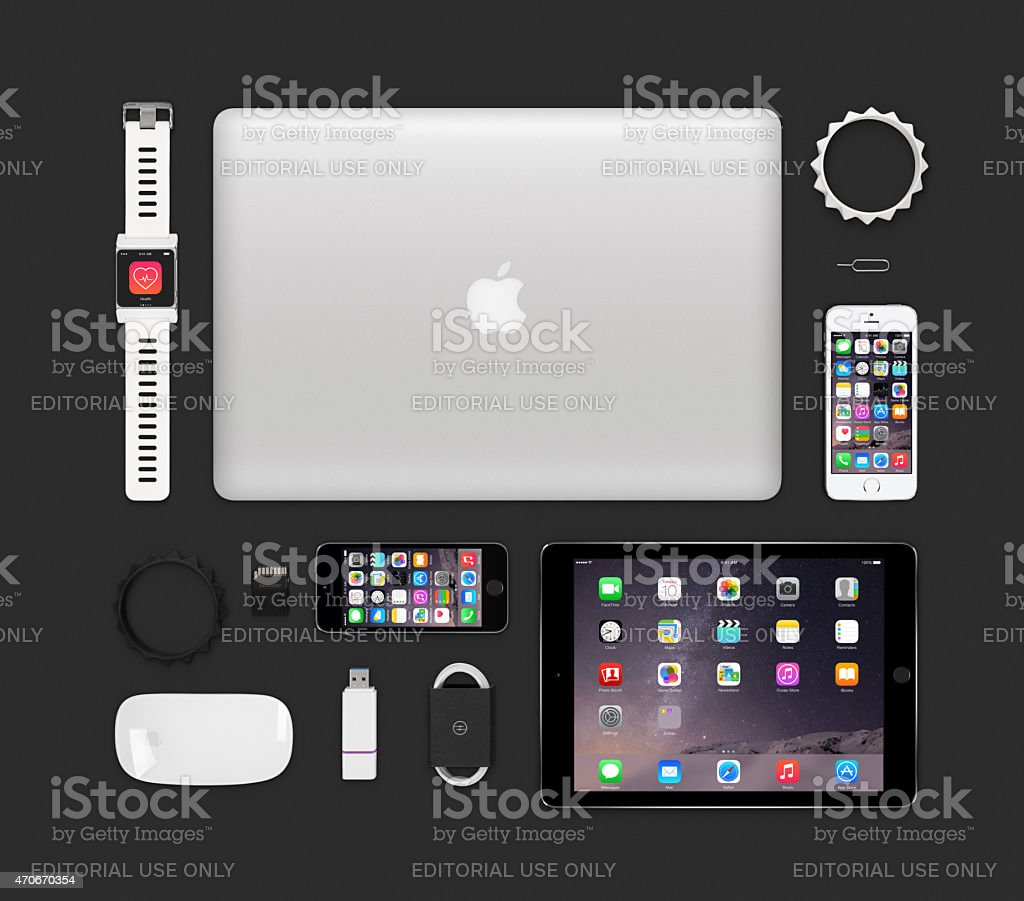 Top view of Apple products tech mockup that includes retina macbook...