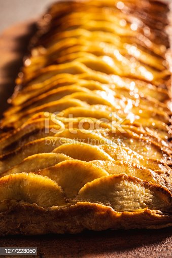 Apple puff pastry pie sliced cross section cut selective focus of foreground