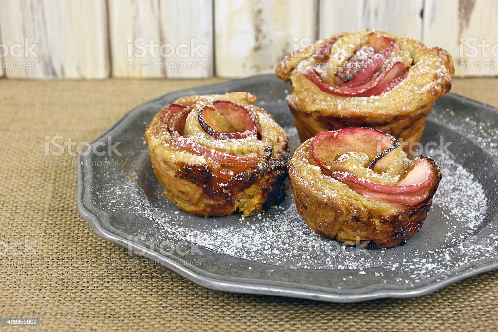 apple rose pastry on pewter stock photo