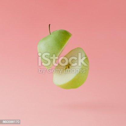 istock Apple sliced on pastel pink background. Minimal fruit concept. 860588170