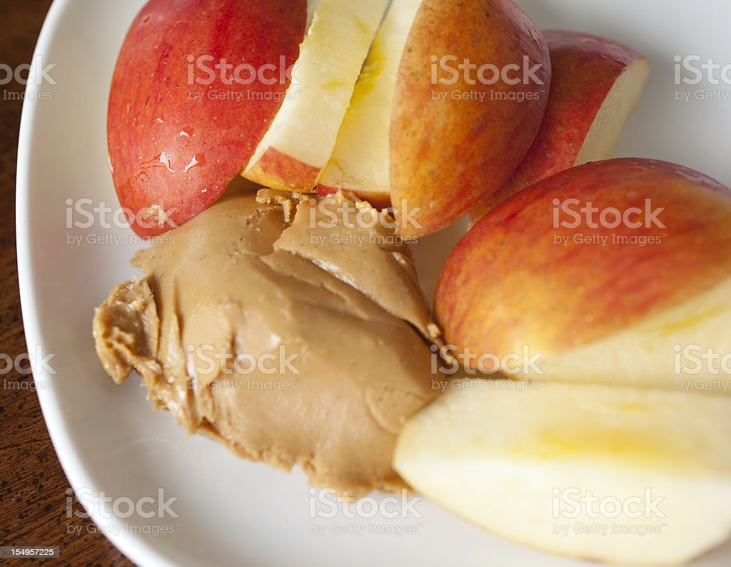 Apple Slices with Peanut Butter Snack stock photo