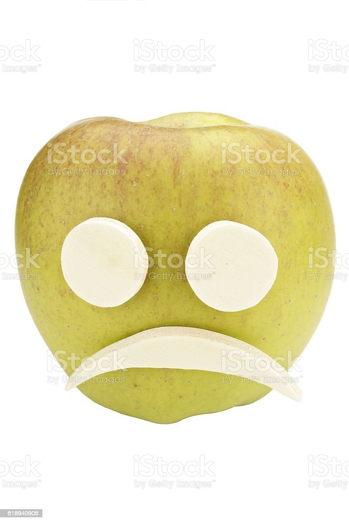 Apple smiley face with sad expression stock photo