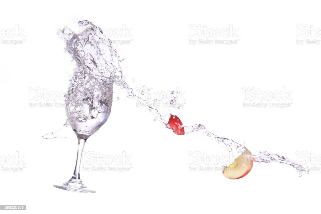 apple spashing into wine glass stock photo
