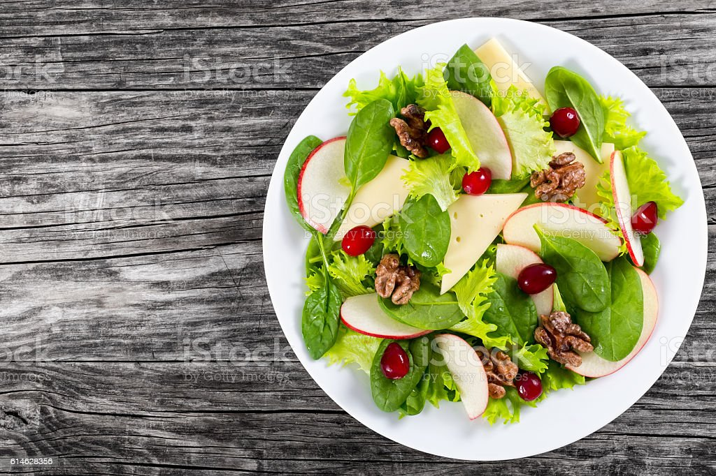 apple, spinach, cheese, lettuce leaves, caramelized walnuts, cra stock photo