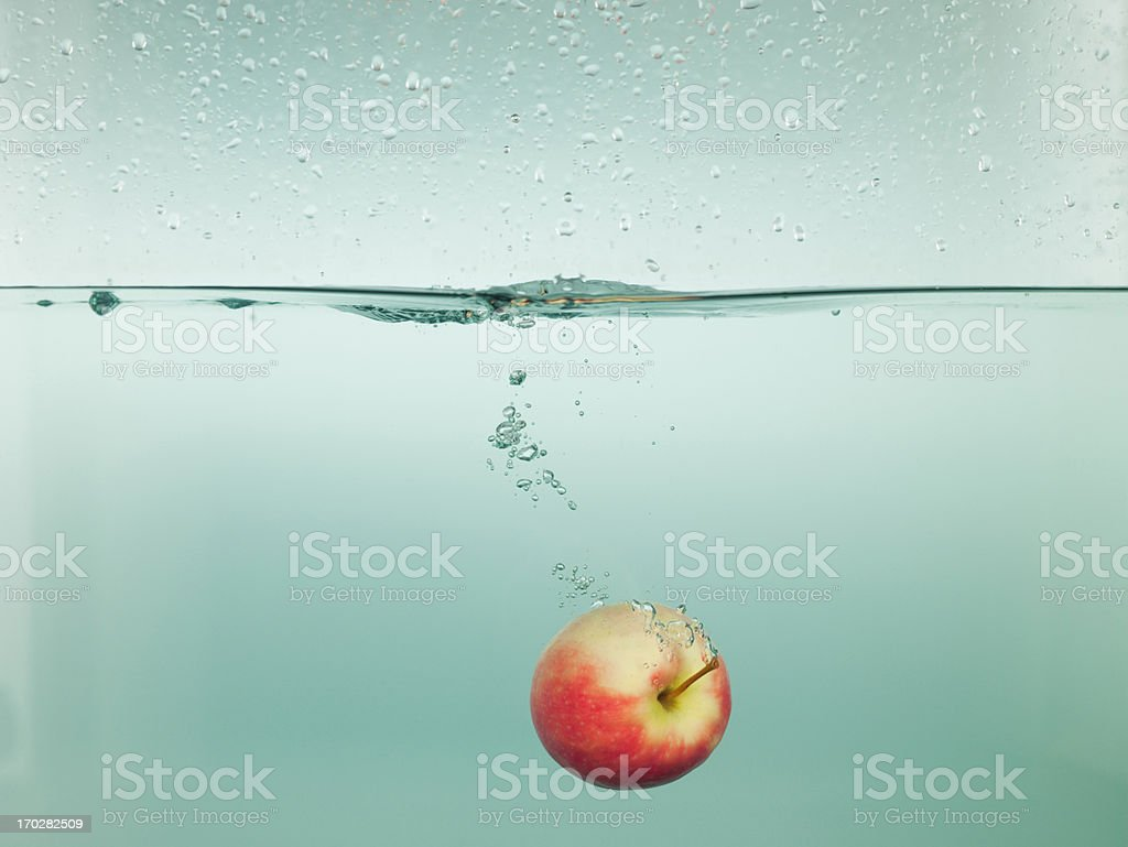 Apple splashing in water stock photo