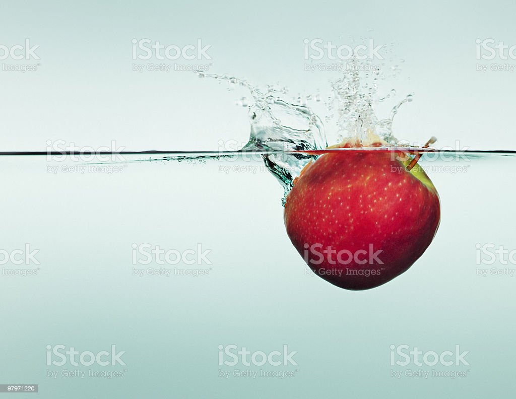 Apple splashing in water royalty-free stock photo
