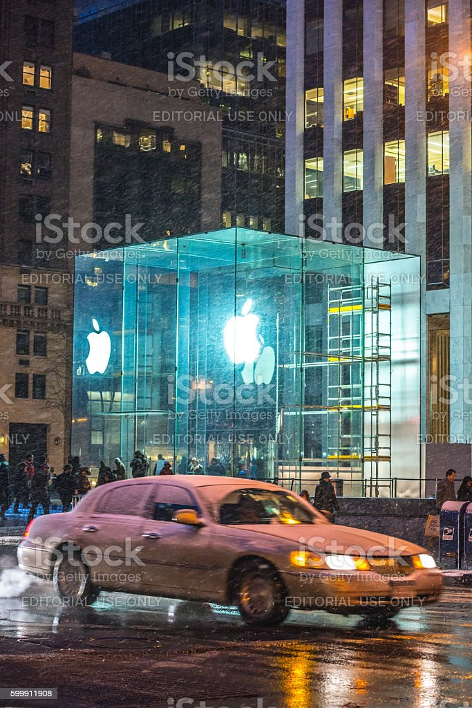 Apple Store and car in snow on 5th Avenue, NYC stock photo