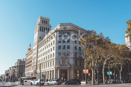 Barcelona, Spain - 05 December 2017: Apple store located in the heart of Barcelona,Plaza Catalunya.The Apple logo is changed to red colour for World AIDS Day.