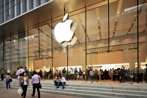Shanghai, China - October 12, 2011:  Glass entrance to the Apple Store at Nanjing road opened on the September 23, 2011. Many people inside and outside the shop.
