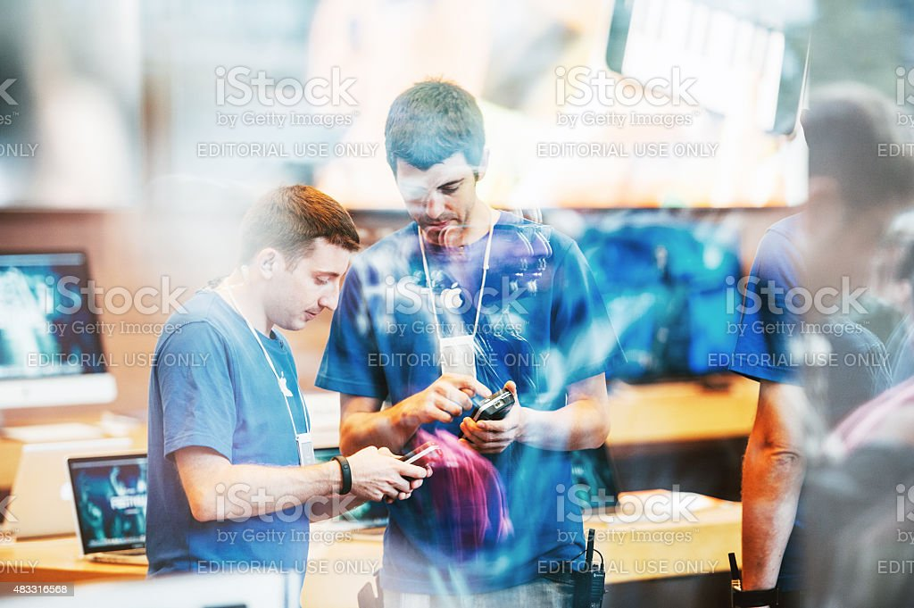 Apple Store interior reflected with customers waiting in line outside stock photo