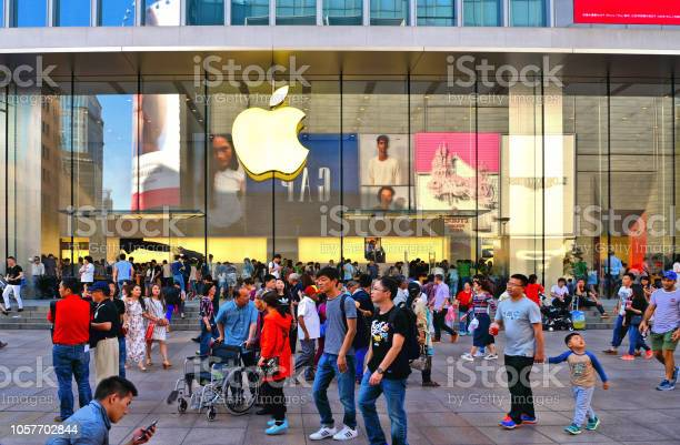 Apple Store Window With Sign In Nanjing East Road With People Who Often Line Up To Grab On One Of The Companys Latest Gadgets Shanghai China Stock Photo - Download Image Now