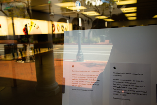 istock Apple Store with closed signs due to Covid-19 quarantine 1217601854