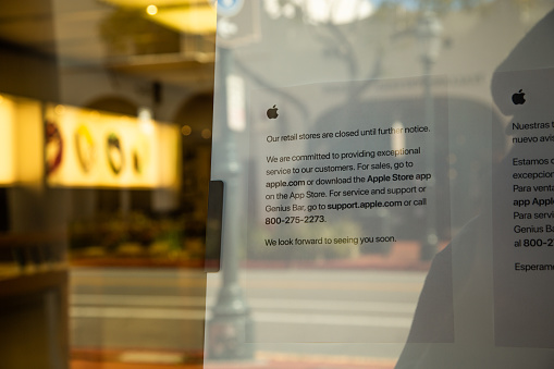 istock Apple Store with closed signs due to Covid-19 quarantine 1217885852