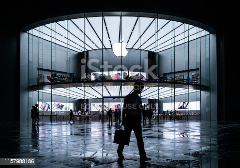 Nanjing, China - June 20, 2019: Apple stores in the evening, busy Apple stores and people on the road.