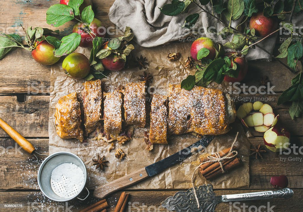 Apple strudel cake with cinnamon, nuts and sugar powder stock photo
