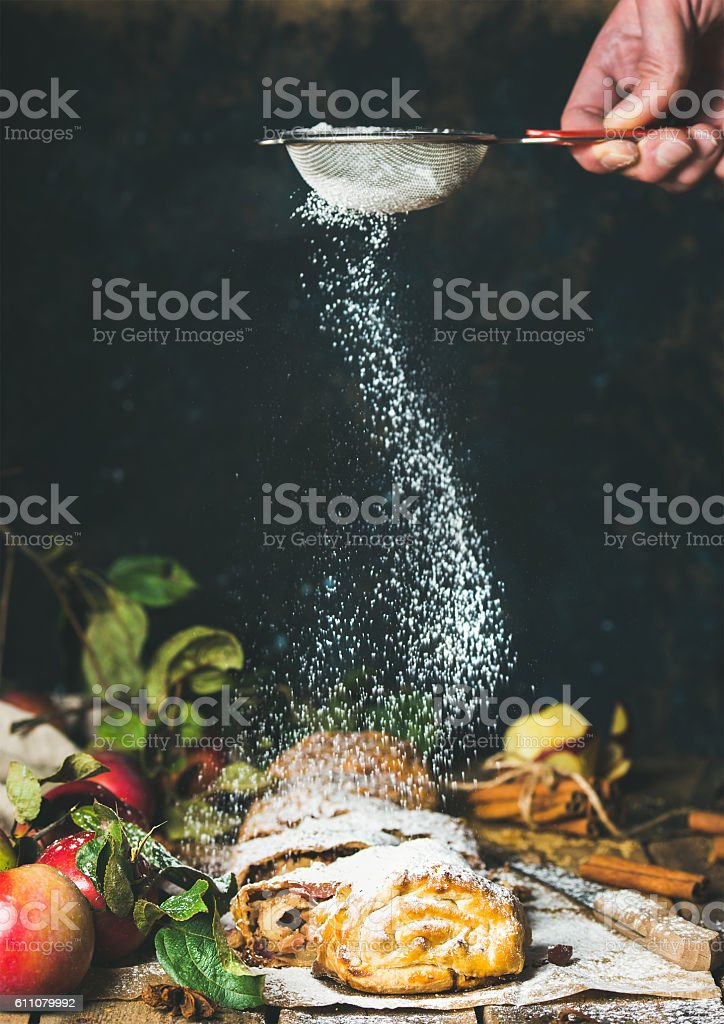 Apple strudel cake with cinnamon, sugar powder and fresh apples stock photo