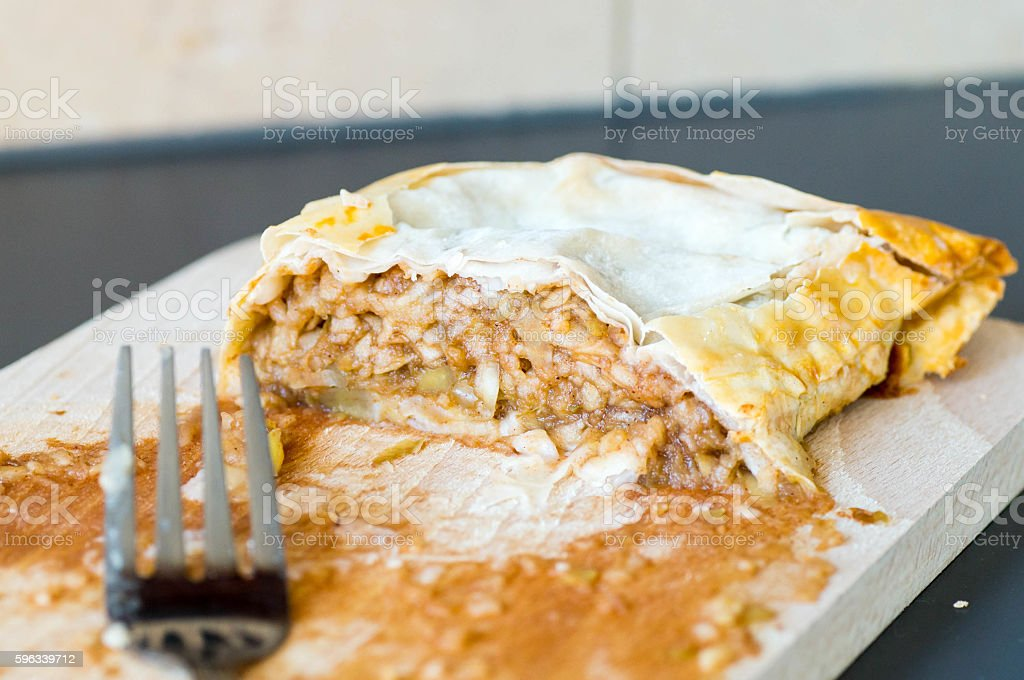 Apple strudel piece on a wooden board royalty-free stock photo