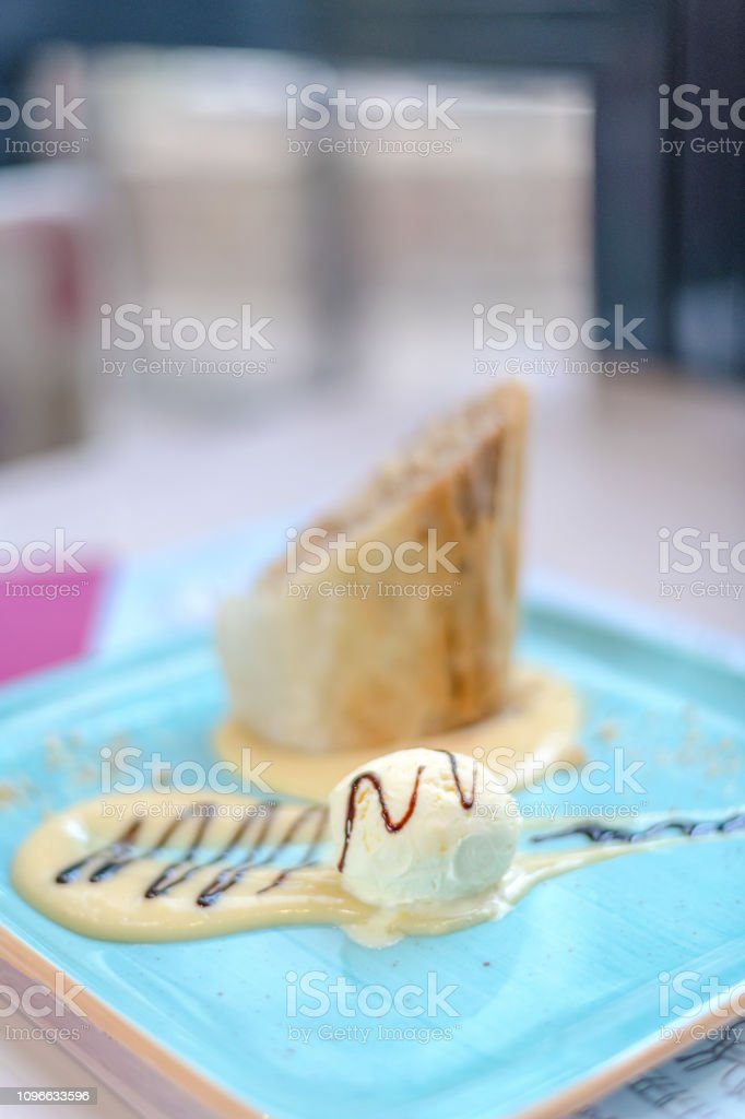 Apple strudel with vanilla ice cream stock photo